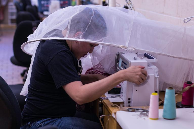 Kaitlin Fara works on Mother Ginger's hoop skirt