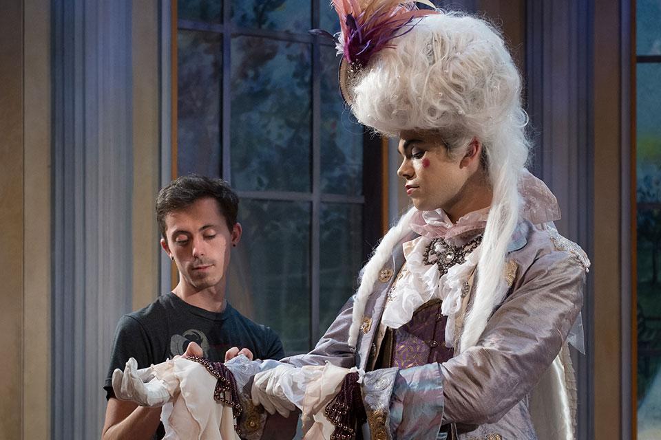 Costume Designer Jordan Jeffers adjusting Sir Fopling's costume. / Photo: Peter Mueller