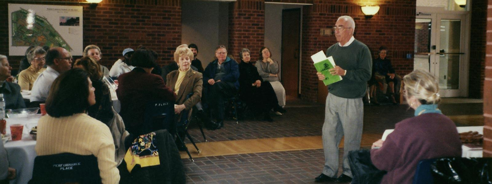 Former Drama Dean Gerald Freedman giving a talk, 1997.