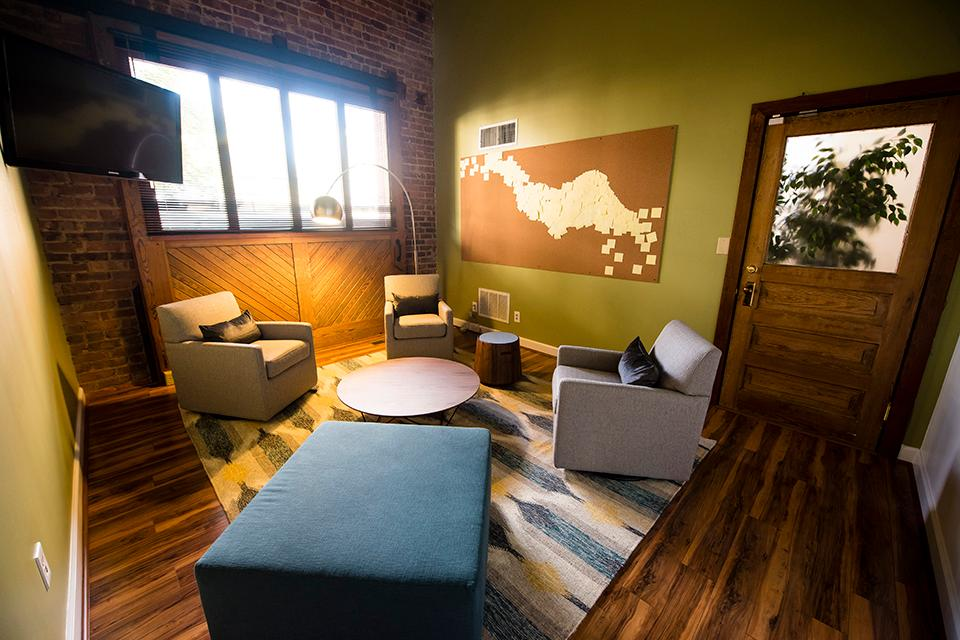The breakout room can accommodate 4 to 6 people in a relaxed conversational arrangement.
