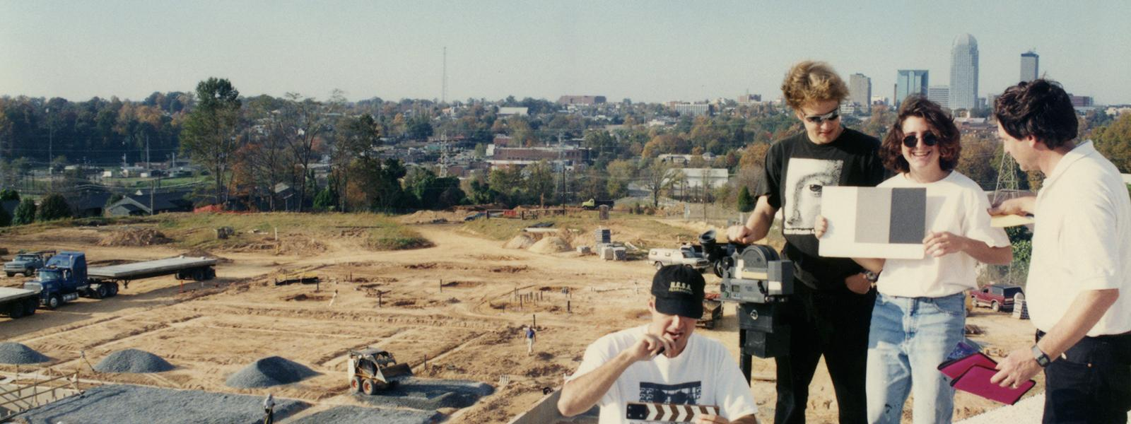 Students and faculty member documenting the construction progress of the School of Filmmaking's Studio Village, 1996.