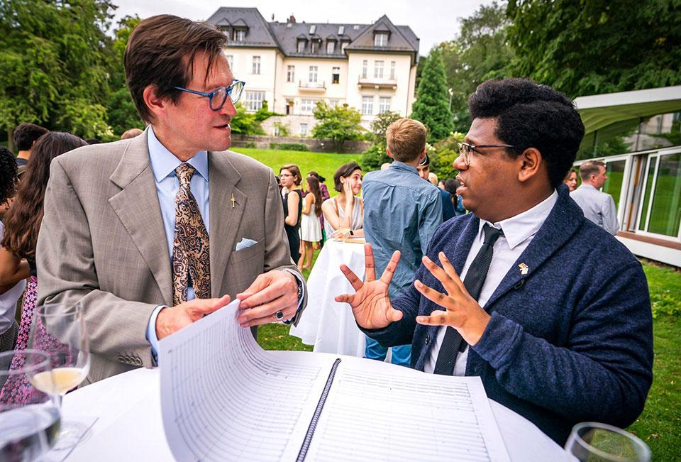 Tyson J. Davis (right) talking with David Mees, Cultural Attache to the U.S. Embassy in Berlin. / Photo: Chris Lee Photographer