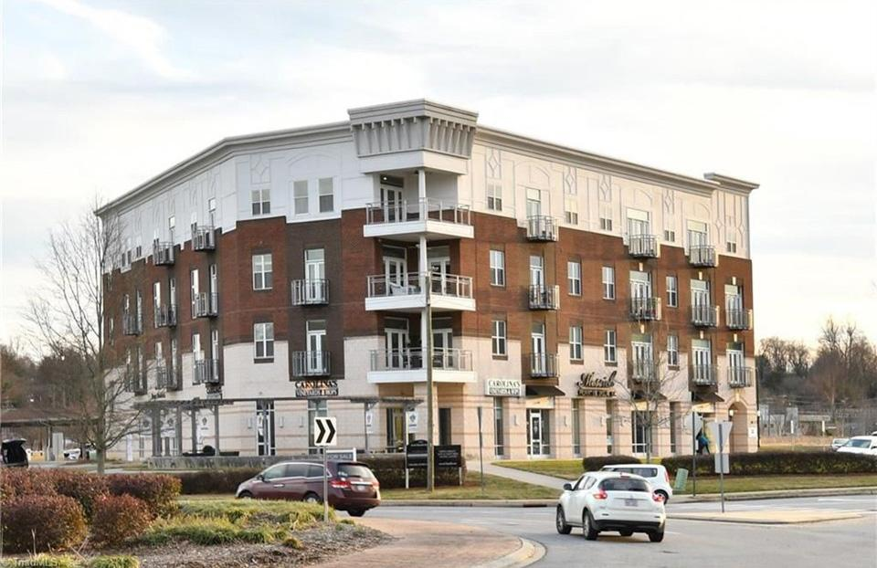 Existing Gateway Lofts building next to the Gateway Loft Apartments under construction.