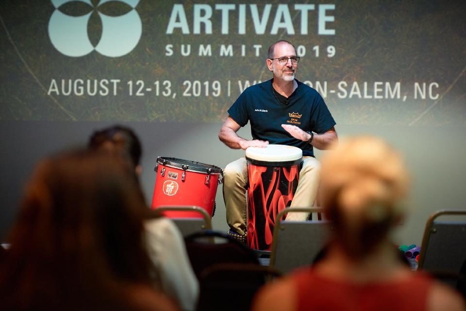 UNCSA percussion instructor John Beck closes Artivate with a therapeutic drumming session.