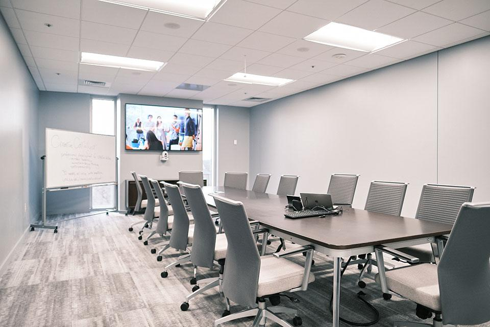 The Board Room has capacity for up to 14 people and includes a flatscreen TV, whiteboard, Apple TV and other technologies.