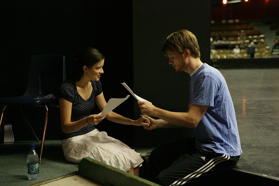 """Anna Wood '08 and Paul Baswell '08 read lines during """"West Side Story"""" auditions."""
