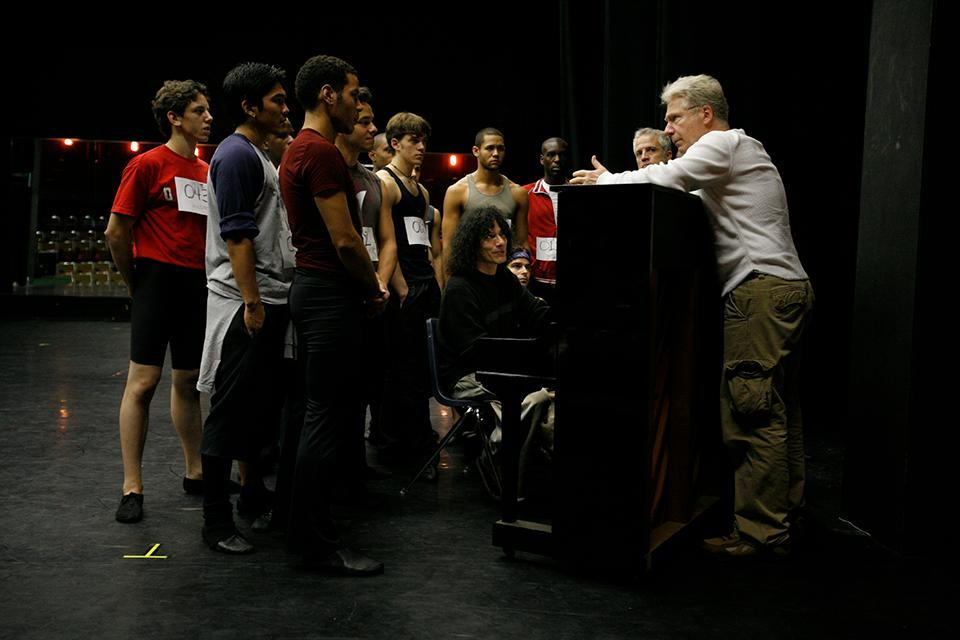 John Mauceri instructs students during group auditions.