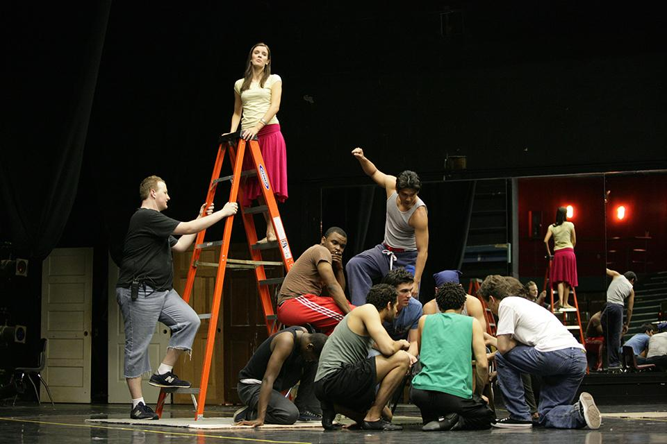 "Anna Wood '08 as ""Maria"" and students in rehearsal for ""West Side Story"""