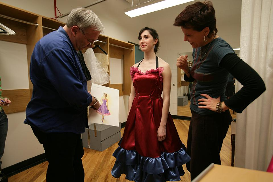 "A student attends her costume fitting for ""West Side Story."""