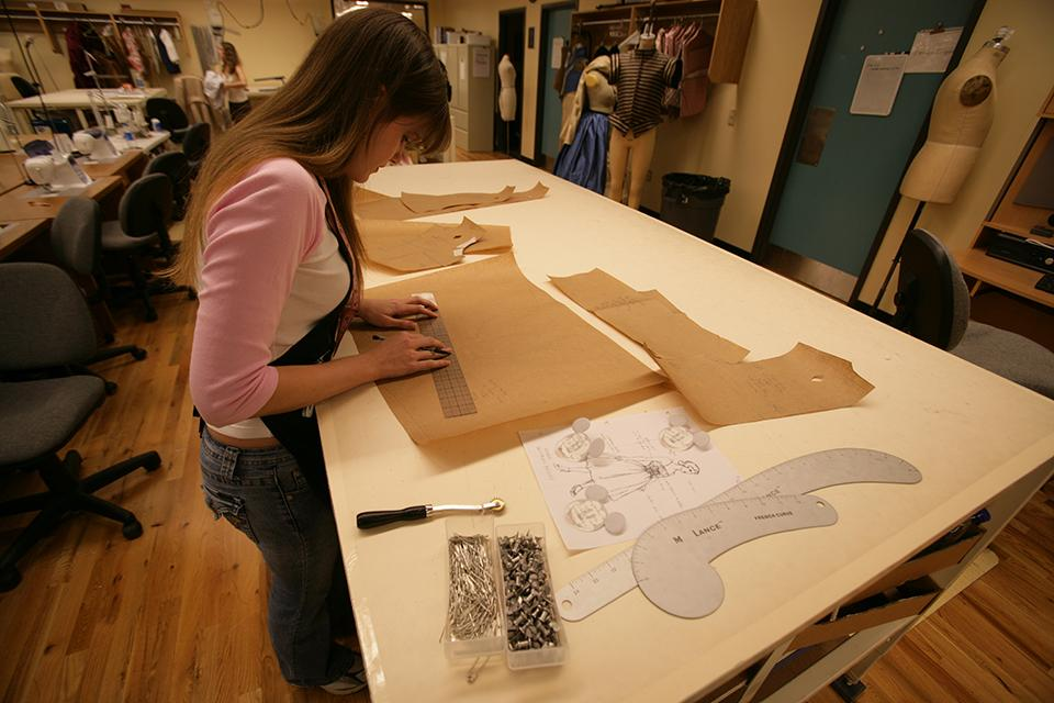 """A student works on costume patterns for """"West Side Story."""""""