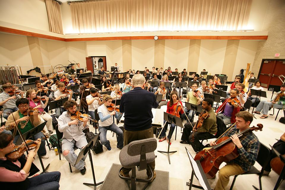 "John Mauceri conducts a ""West Side Story"" orchestra rehearsal."