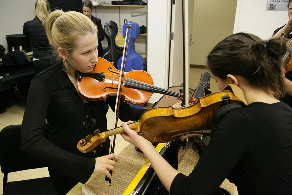 Musicians warm up backstage at Stevens Center before a performance.