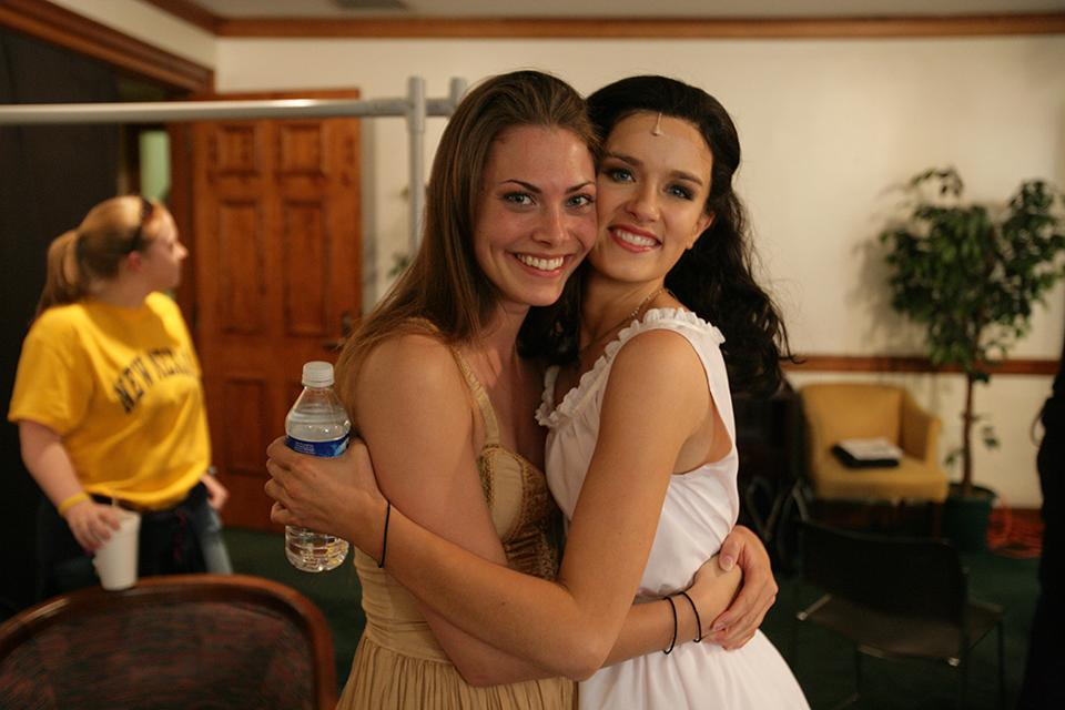 Katharine Elkington '08 and Anna Wood '08 embrace backstage on a performance night.