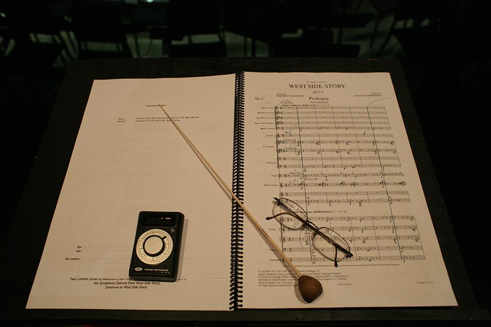 """The conductor's stand is set for """"West Side Story"""" rehearsal."""