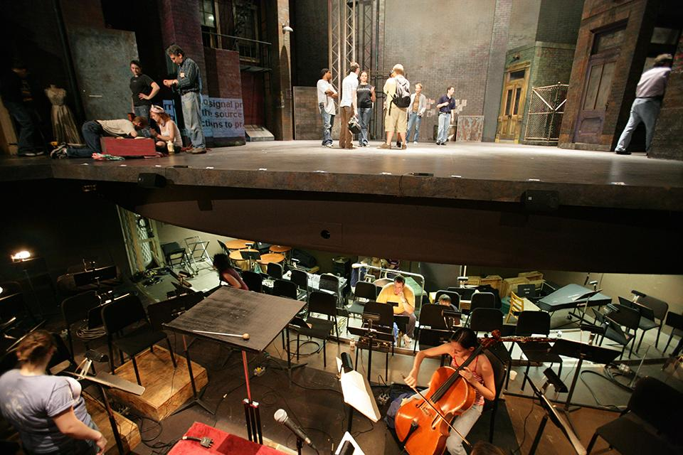 "A student warms up in the pit before a ""West Side Story"" rehearsal."