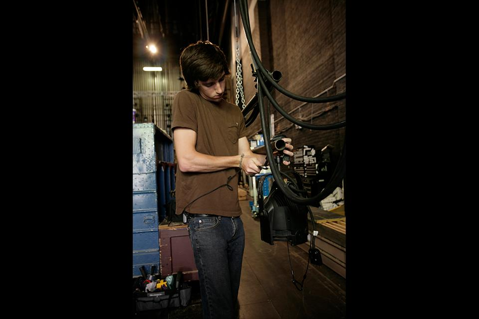A lighting students sets up a rig at the Stevens Center.