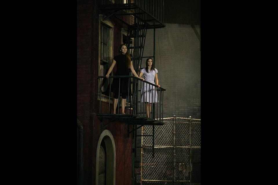 """Katharine Elkington and Anna Wood stand on the famed """"West Side Story"""" balcony."""