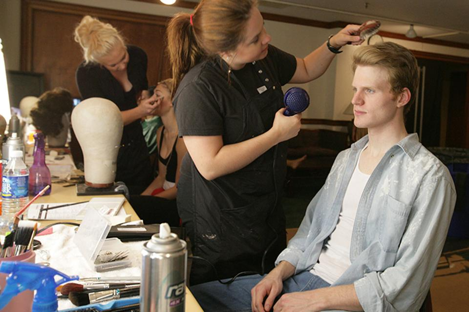 Paul Baswell '08 has his hair styled before a performance.