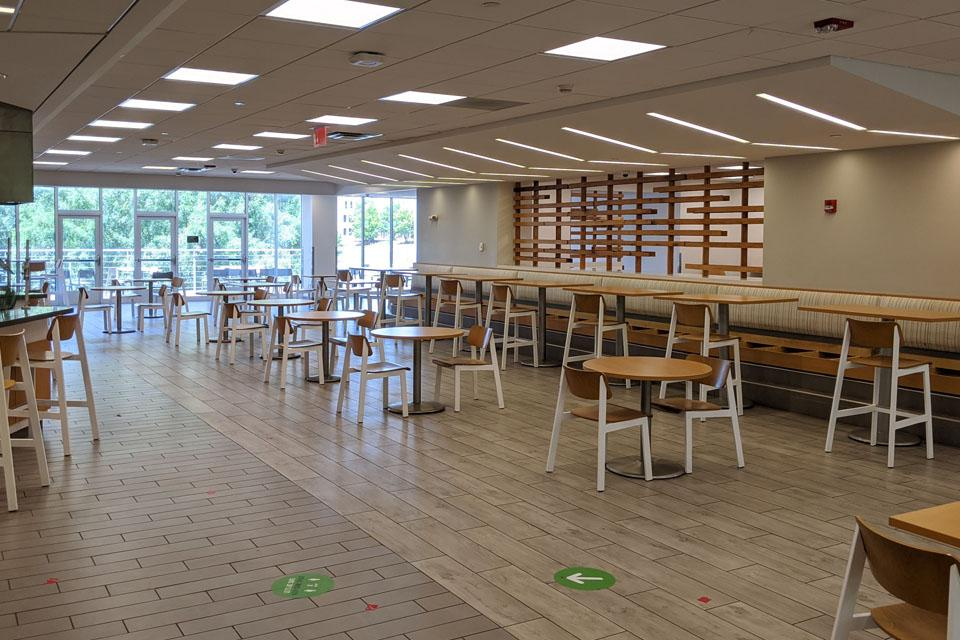 The bench seating has been removed and fewer tables and chairs are in the Dining Hall.