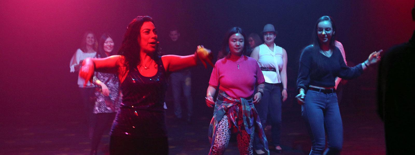 "Carmen Aguirre performing ""Broken Tailbone."" / Photo: Collins Maina"