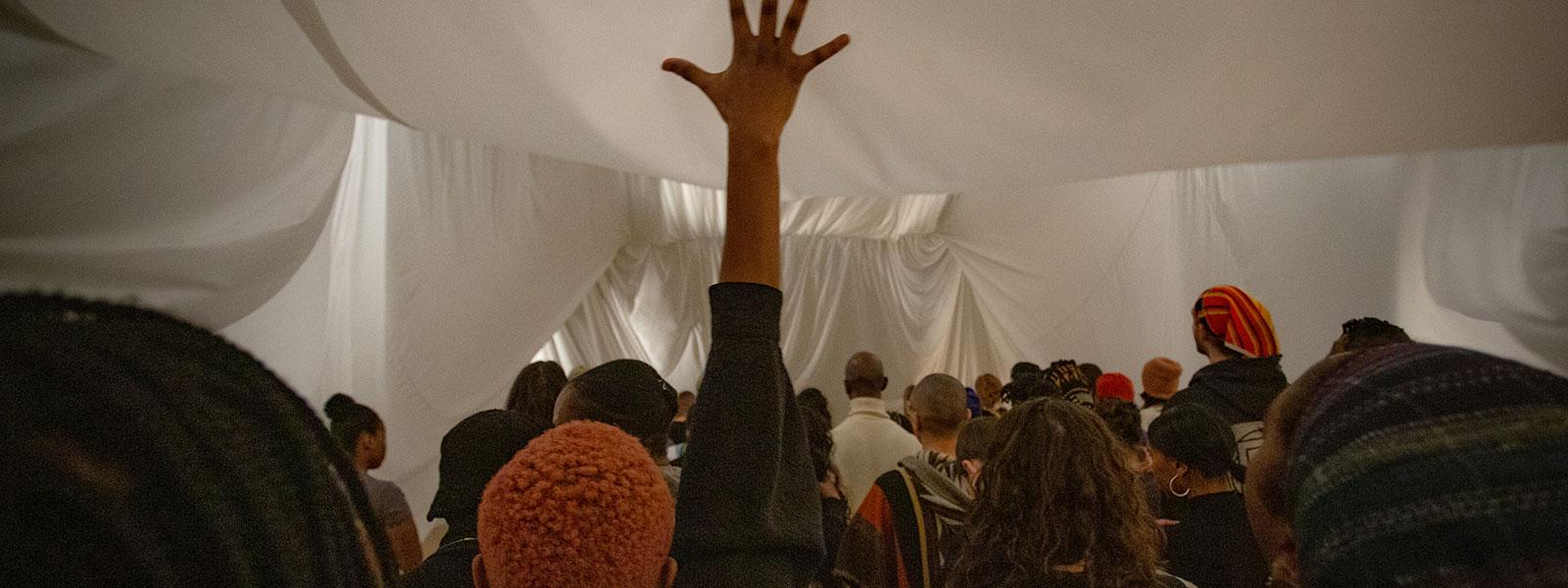 "Okwui Okpokwasili in ""Sitting on a Man's Head,"" Danspace Project, February 2020. Photo: Tony Turnerto: Tony Turner"