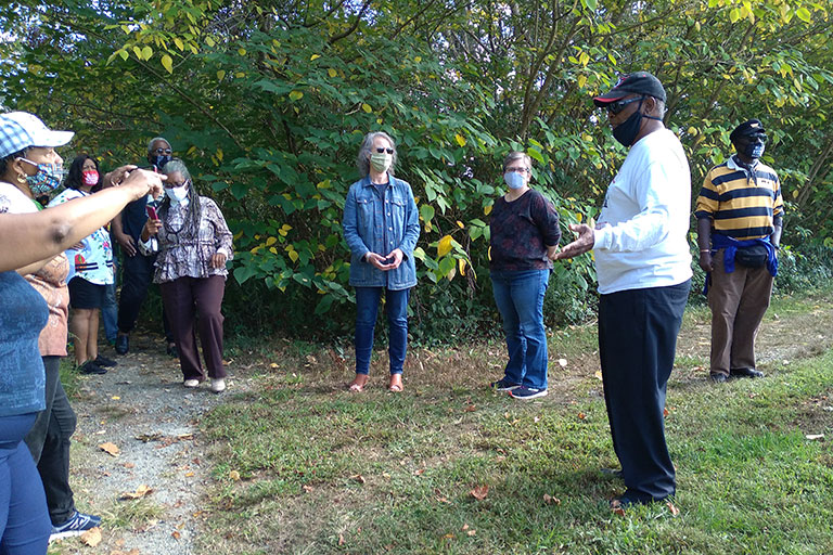 A bus tour of the Happy Hill neighborhood with community members and stakeholders in October identified locations on the Cultural Asset Map and informed the in-person community workshop. / Photos: Owens Daniels