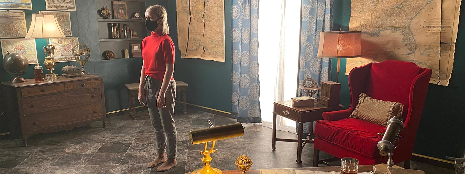 """Scene from """"Alone Together"""" on Grant West's set themed as an Old World cartographer's studio."""