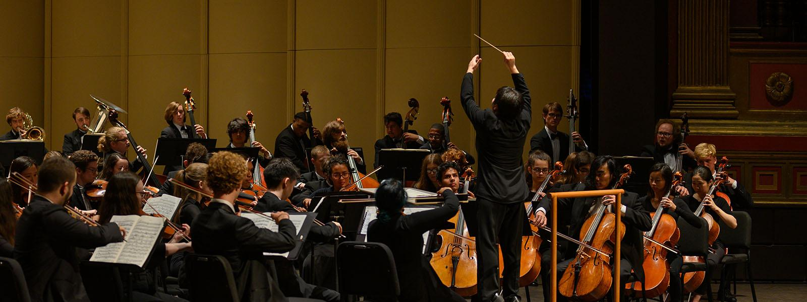 World-renowned guest conductor Xian Zhang leading the UNCSA Symphony Orchestra / photo: Peter J. Mueller
