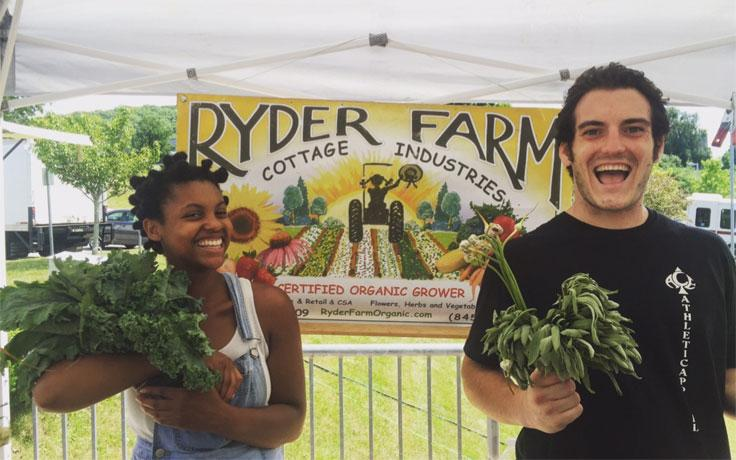 Ariel Blake and Matt Foley with some scrumptious greens at the farmer's market.