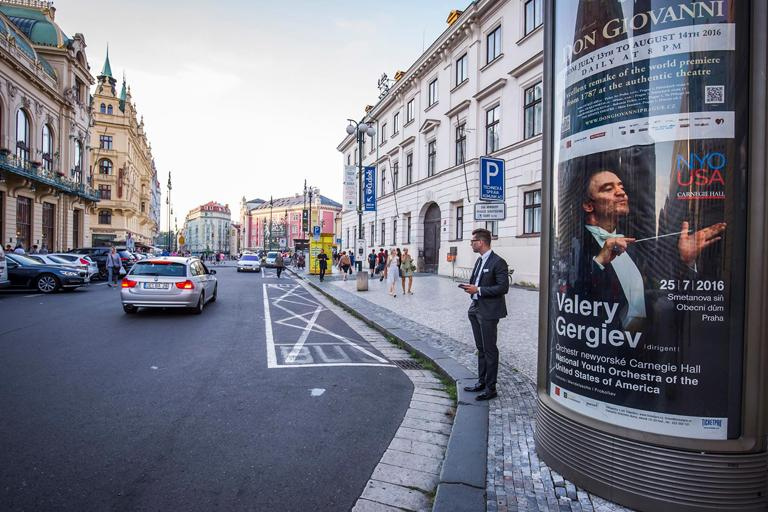 A National Youth Orchestra - USA poster advertises the concert on the city street in Prague. Photo: Chris Lee