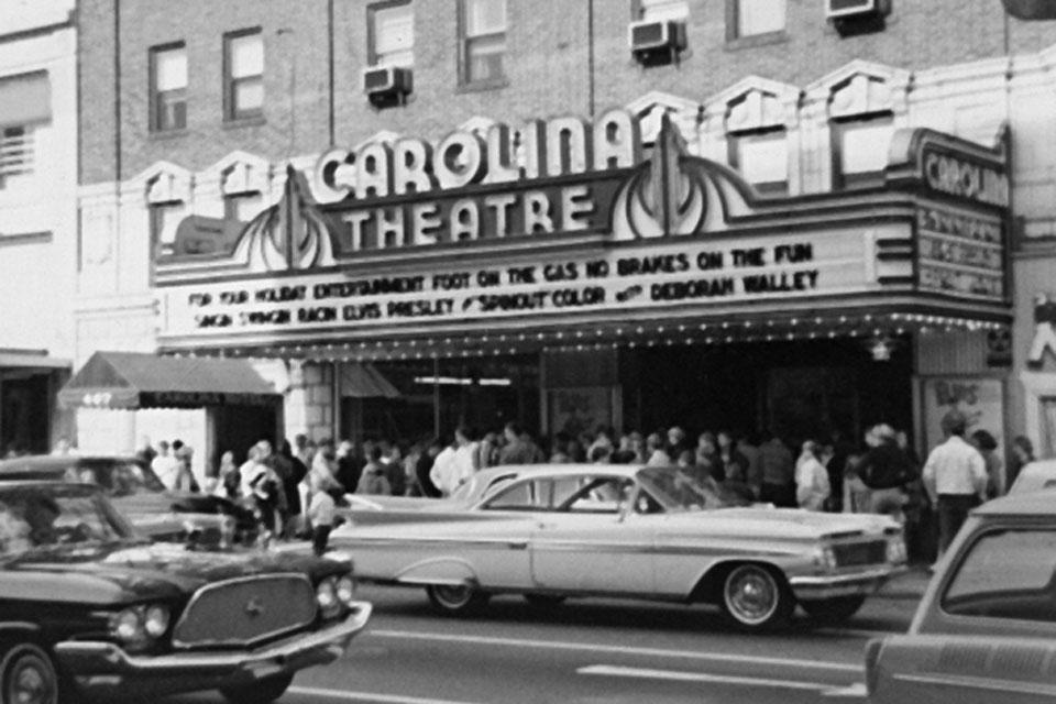 Marquee at the Carolina Theatre and Hotel announcing shows, including a performance by Elvis Presley (1958). Photo: UNCSA Archives