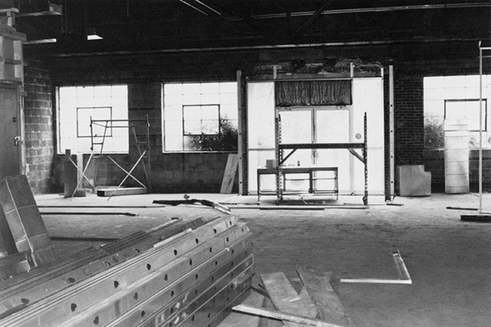 Construction of the current Design & Production Building (1990-91). Portions of the building include the renovated Triad Mack Truck Sales and Service building. Photo: UNCSA Archives