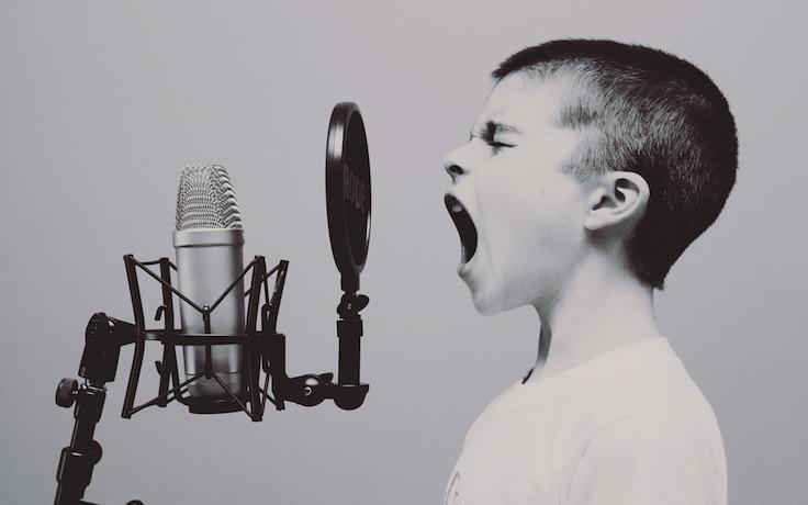 Kid screaming at microphone
