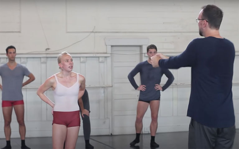 Trey McIntyre instructing dancers in a studio
