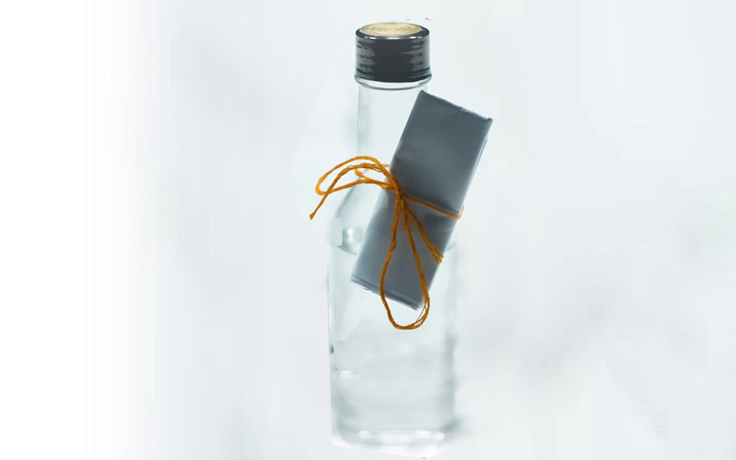 Bottle with a note attached