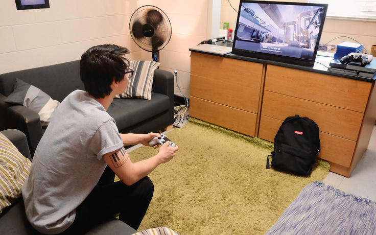 male playing video game