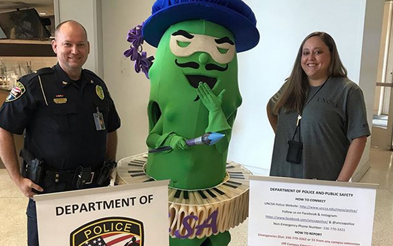 Campus police with pickle mascot