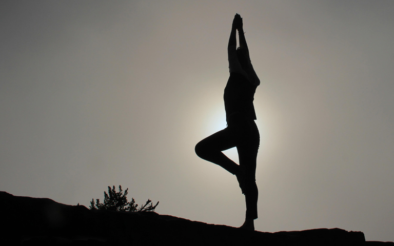 Silhouette of person doing yoga