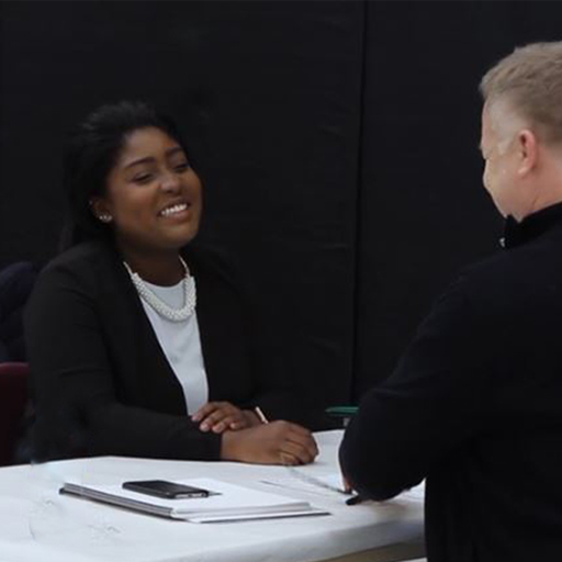 Student interviewing at job fair