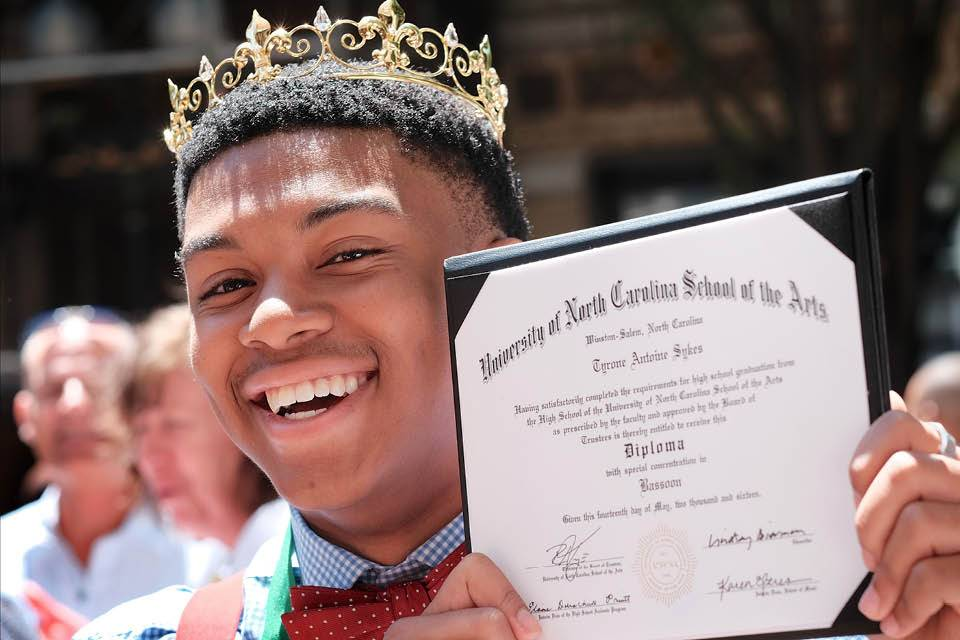 Tyrone Sykes shows off his diploma
