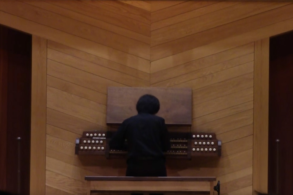 Bruce Xu performing in Crawford Hall